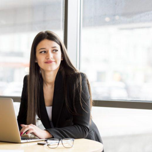 brunette-businesswoman-with-laptop_23-2148142786
