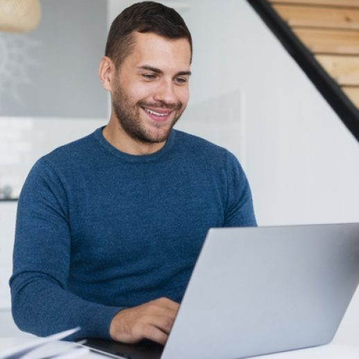 smiley-man-working-laptop-home_23-2148306571